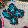 Albanian Knotted Flower Cushion Natural Small butterfly detail