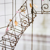La Lecture Light, detail of staircase with flowers