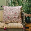 Kollam Blush Cushion (against back of sofa)