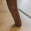 Crawford Armchair Rio Olive, detail of back leg