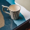 Graphite Wabi Sabi Rectangular Glass Serving Tray with cup, showing reflection