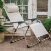 Amida Armchair in White/Beige - lounging position