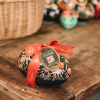 Large Fine de Champagne Truffle Eggs - in black with red flowers pattern