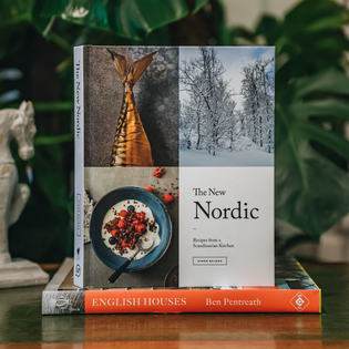 The New Nordic: Recipes from a Scandinavian Kitchen by Simon Bajada (the horse bookend is available in store)
