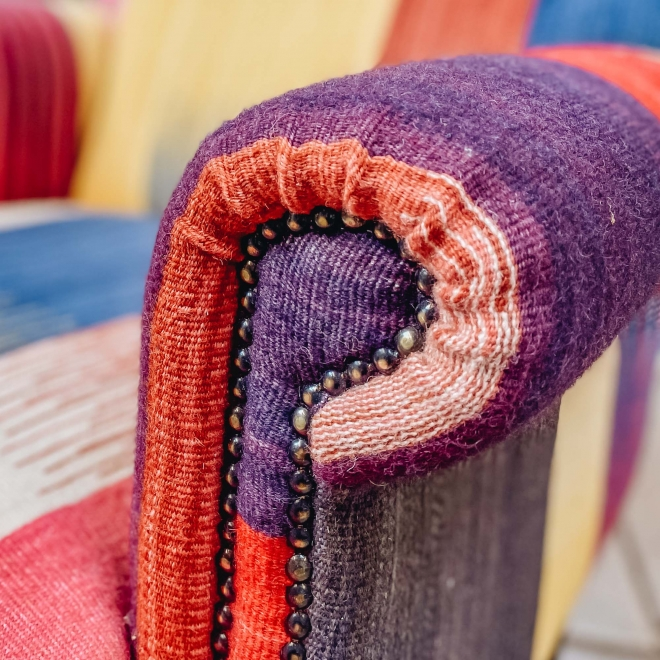 Modern Kilim Armchair, detail of arm with brass tacks