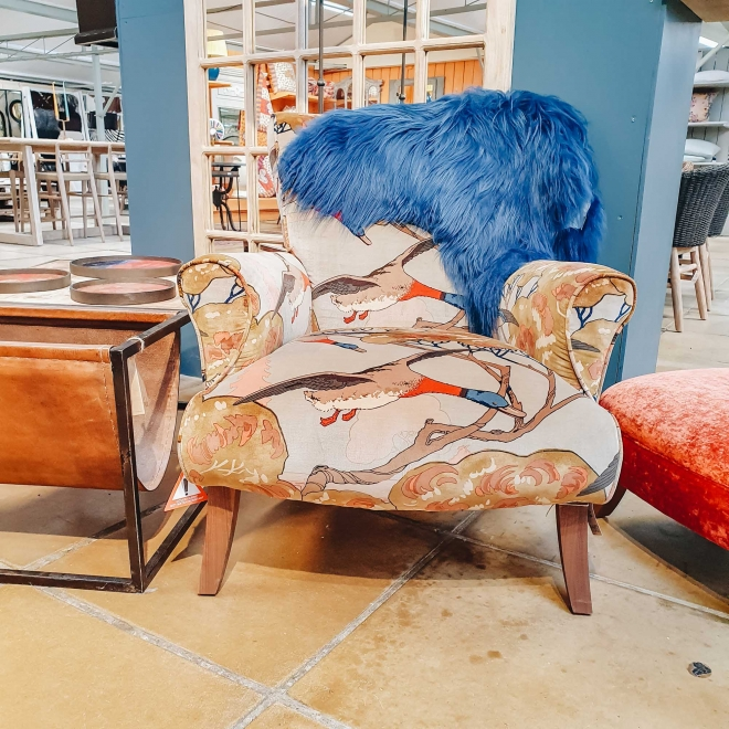 Flying Duck Stirling Armchair, shown with Swedish Sheepskin
