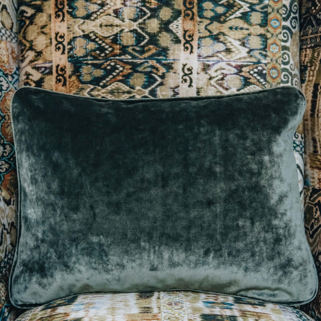 Crawford Armchair Rio Olive, detail with Opium Emerald cushion