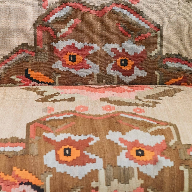 Ganesh Kilim Chesterfield Sofa, detail of Ganesh heads on the seat