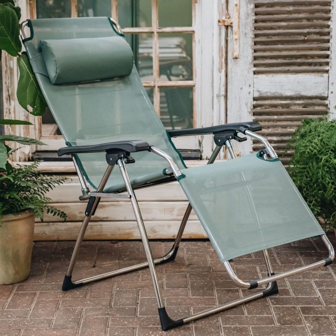 Amida Armchair in Sage Green - lounging position