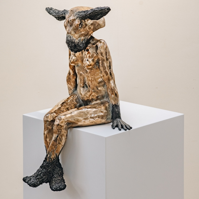 Gary Betts: Woman, Lamb's Head, with lamb's head on, from side